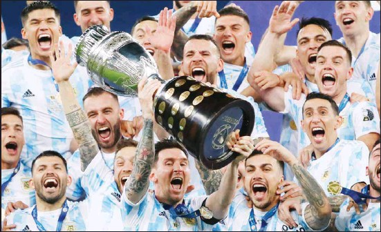 ??  ?? Argentina's Lionel Messi celebrates with the trophy after beating Brazil 1-0 in the Copa America final soccer match at Maracana Stadium in Rio de Janeiro, Brazil. (AP)