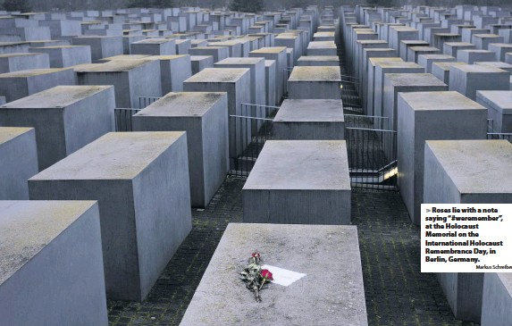 "?? Markus Schreiber ?? Roses lie with a note saying ""#weremember"", at the Holocaust Memorial on the Internatio­nal Holocaust Remembranc­e Day, in Berlin, Germany."