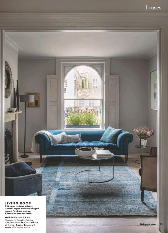 ??  ?? LIVING ROOM Soft tone-on-tone velvets, curved shapes and hand-forged bronze furniture sum up Solenne's clean aesthetic. Walls in Farrow & Ball's Elephant's Breath. Gatsby sofa; Moon table; Coco mirror, all Ochre. Bowls; Taroudant vases, all Canvas Home