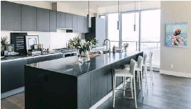 ??  ?? The sleek kitchen has cabinets imported from Italy and a spacious island.