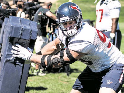 ?? Brett Coomer / Houston Chronicle ?? J.J. Watt says missing practice time, like Tuesday's workout with the Broncos in Englwood, Colo., or games because of a contract dispute is out of the question.