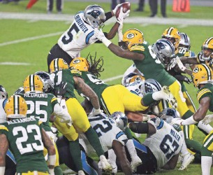 ?? GETTY IMAGES ?? Packers linebacker Krys Barnes forces Carolina quarterback Teddy Bridgewater to fumble at the goal line.