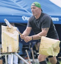 ??  ?? Splitting image . . . Darren Falconer, of Dunedin, competes during the Otago Axeman's Club timber sports demonstration.