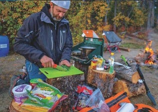 ??  ?? Taco Tuesday looks different on the banks of the Yukon River, where Stu Knaack has been outfitting custom trips for a decade.