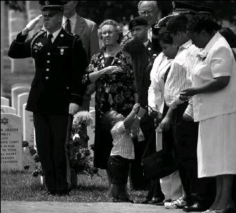 ?? BY LOIS RAIMONDO — THE WASHINGTON POST ?? Greg Sutton, center, reaches for his mother, Joanne Sutton, at the burial of his father, Sgt. 1st Class Greg L. Sutton.