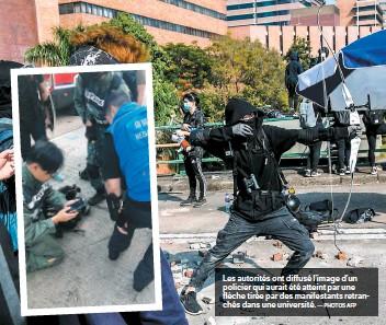 ?? — PHOTOS AFP ?? Les autorités ont diffusé l'image d'un policier qui aurait été atteint par une flèche tirée par des manifestants retranchés dans une université.
