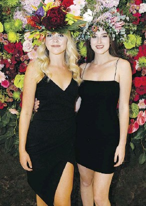??  ?? London Tunke, left, and Kate Andrychuk show off their ornate floral hats. Fleurs de Villes features the works of 15 local florists.