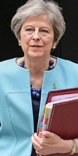 ??  ?? Defiant: Theresa May heads for the Commons yesterday