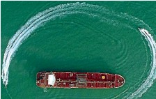 ?? AP ?? Speedboats from Iran's Revolutionary Guard circle the Britishflagged oil tanker Stena Impero.