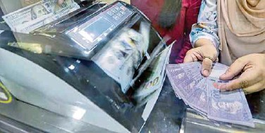 ??  ?? At Friday's close, the ringgit was quoted at 4.1310/1360 against the US dollar from 4.1640/1670 the week before.
