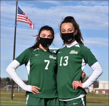 ?? BY KYLE ADAMS KADAMS@SARATOGIAN.COM @KASPORTSNEWS ON TWITTER ?? Maia LaVigne (#7) poses with teammate and fellow captain Sophia DeMura (#13) at their home field on November 21, 2020.