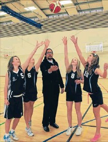 ?? Photo: COLIN SMITH/FAIRFAX NZ ?? Let's start: Basketball coach Dominic Topia tips off for Nelson College for Girls players Alice Hazlett, left, Emily Mills, Fran Hills and Pip Dwyer.