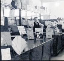 ??  ?? A young Pat Stephens in his Te Awamutu menswear shop, Pat Stephens Menswear.