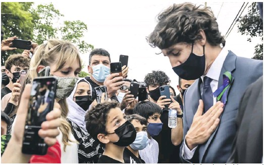?? PHOTOGRAPH: NATHAN DENETTE/ CANADIAN PRESS/ ZUMA/EYEVINE ?? Justin Trudeau, Canada's prime minister, greeting mourners before the vigil for the Afzaal family