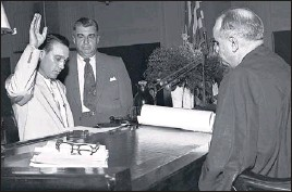 ??  ?? THE COMMERCIAL APPEAL FILES William Ernest Smith (left), 37-year- old Selmer Republican, assumed the duties of United States marshal of West Tennessee after taking the oath of office from Federal Judge Marion S. Boyd (right) in June 1954. On hand was...