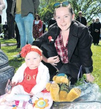 ?? PHOTO: GRE­GOR RICHARD­SON ?? Mak­ing the ef­fort . . . Mad­di­son Rus­sell (8 months) and her mother Sa­man­tha Rus­sell soak up the scene at Queens Gar­dens in Dunedin dur­ing the Armistice Day ser­vice yes­ter­day morn­ing.
