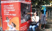 ?? PTI ?? A health worker collects swab sample Bus Depot, in Mumbai, on Tuesday for Covid-19 test near Andheri