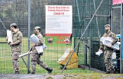 ??  ?? Members of the Royal Scots Dragoon Guard set up a coronavirus vaccination centre in Drumchapel, Glasgow, as part of the largest peacetime resilience operation ever undertaken by the British Army