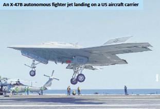??  ?? An X-47B autonomous fighter jet landing on a US aircraft carrier
