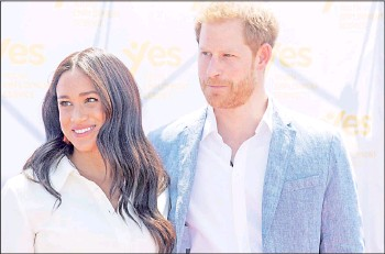 ?? — AFP file photo ?? Harry and Markle look on at the Youth Employment Services (YES) Hub as they visit a township in Johannesburg, South Africa, Oct 2, 2019.