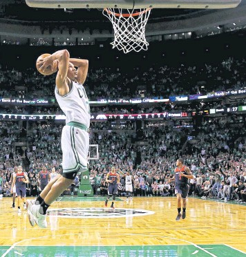 ?? AFP ?? The Celtics' Avery Bradley dunks against the Wizards during the first half of Game Five.