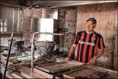 ??  ?? Der Gastronom Wolfgang Ewerts in der völlig zerstörten Küche seines Hotels am Ufer der Ahr – er will alles wieder aufbauen.