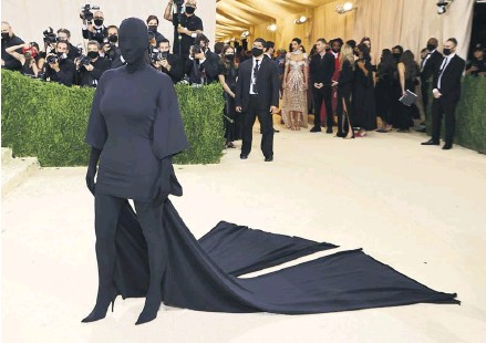 ?? PHOTOGRAPH: MIKE COPPOLA/GETTY ?? Kim Kardashian West, one of the most recognisable women in the world, covers up in Balenciaga