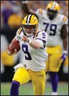 ?? Associated Press photo ?? LSU quarterback Joe Burrow runs against Clemson during the first half of a NCAA College Football Playoff national championship game Monday in New Orleans.