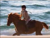 ?? (DR) ?? Une après-midi à cheval avec Madonna.