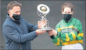 ??  ?? Rachael Blackmore and Trainer Henry De Bromhead celebrate with the trophy after yesterday's success