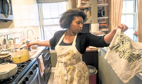 ??  ?? Christienne Dobson prepares for a 'Taste Of Trinidad' dinner party at her apartment in New York.