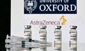 ?? Photograph: Justin Tallis/AFP/Getty Images ?? About 20m Oxford/ AstraZeneca doses had been administered in the UK by the end of March.