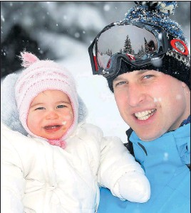 ?? Pictures: JOHN STILLWELL/ PA ?? All wrapped up... Charlotte gets a cuddle from father Prince William