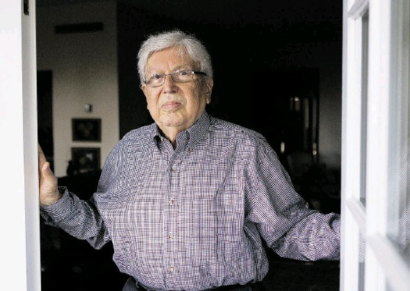 ?? JOHN KENNEY/ MONTREAL GAZETTE ?? Paul Herczeg, 87, shown at his Montreal home on Wednesday, is a survivor of Auschwitz and the Muehldorf slave labour camp. He barely escaped death on more than one occasion and was liberated in April 1945. He immigrated to Canada in 1947.