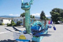 ?? CITY OF KELOWNA ?? The mythical sea monster Ogopogo is shown on a city of Kelowna float. City councillors in the B.C. city decided to maintain images of the mythical lake monster in its parade float.