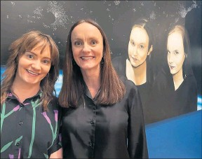 ?? Celebrated work: ?? Fiona and Estelle Parker next to Juan Ford's painting of them, which is on display at Benalla Art Gallery.
