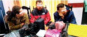 ??  ?? The three Russian suspects and below police with the haul of wildlife species