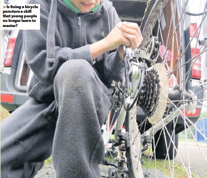 ??  ?? > Is fixing a bicycle puncture a skill that young people no longer learn to master?