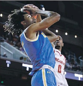 ?? Luis Sinco Los Angeles Times ?? IN HIS ONE SEASON at UCLA, Moses Brown, having his shot blocked by USC's Shaqquan Aaron, averaged 9.7 points and a team-leading 8.3 rebounds.