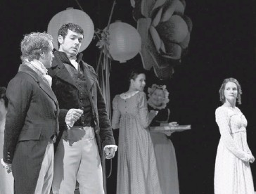 ?? Gavin Young/calgary Herald ?? In their first encounter, Elizabeth Bennet, right, played by Shannon Taylor glances toward Mr. Darcy, centre, played by Tyrell Crews, as he talks with his friend Mr. Bingley played by Brendan McMurtry-Howlett.