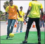 ??  ?? MEMBERS of the Jamaican delegation play soccer at the Forum in Irvine. Several cities in the region are hosting athletes for the Games.
