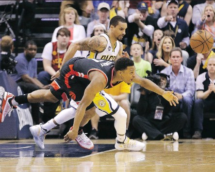 ?? DARRON CUMMINGS/THE ASSOCIATED PRESS ?? Kyle Lowry, front, seen battling the Pacers' George Hill, is missing too many open shots in the playoffs.