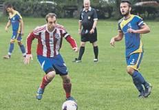 ??  ?? United skipper Cameron Dobson closes down Town captain Ben Briggs