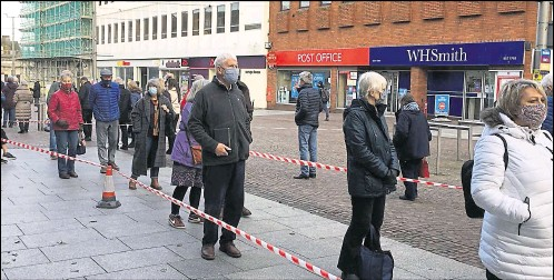 ?? Picture: Anne Smyth ?? People queuing outside the ex-Debenhams in Folkestone waiting for their Covid-19 jab