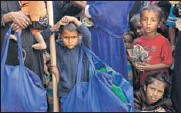 ?? AP ?? Ro­hingya boys stand in a queue out­side a food dis­tri­bu­tion cen­ter at Balukhali refugee camp in Bangladesh.