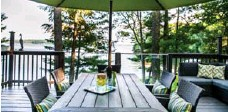 ?? MCMURTRY FAMILY ?? The large deck provides a marvellous view of Lake Muskoka.