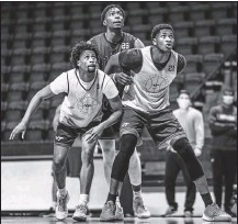 ?? VIRGINIA TECH ?? Freshman guard Darius Maddox (left), junior forward Justyn Mutts (middle) and sophomore forward John Ojiako (right) are three pieces of a Hokies roster seeking flexibility amid uncertainty.