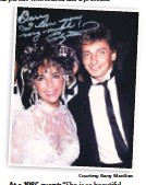 """?? Courtesy Barry Manilow ?? At a 1986 event: """"She is so beautiful. I look like an idiot,"""" Manilow says."""