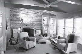 ?? PHOTOS BY KYLE KURLICK / SPECIAL TO THE COMMERCIAL APPEAL ?? Designer John Griffin's remodel features exposed beams and stone fireplace in the living room.