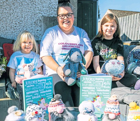 ??  ?? ENTREPRENEUR: Mum Karen Mann with daughters Maisie-Rose and business owner Olivia at home in Glencarse.